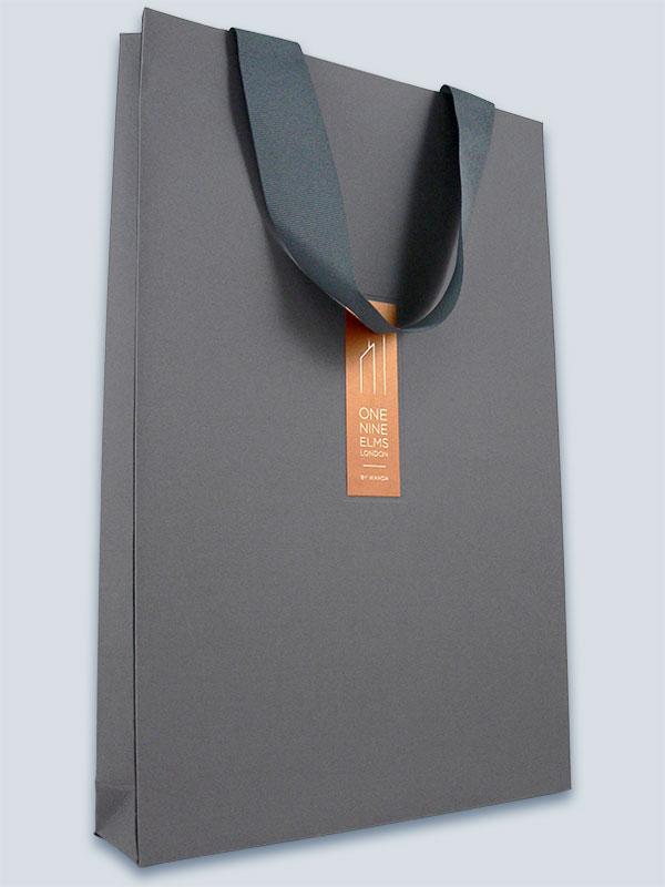 Fabric coated paper, embossed, grosgrain ribbon handles